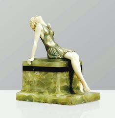 SUN WORSHIPPER', A COLD PAINTED BRONZE AND IVORY FIGURE ON GREEN ONYX AND BLACK MARBLE BASE BY FERDINAND PREISS, CIRCA 1925.