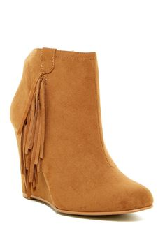 suede fringe adds such a fun detail to this classic bootie lifted by chunky wedge heel. Sponsored by Nordstrom Rack.