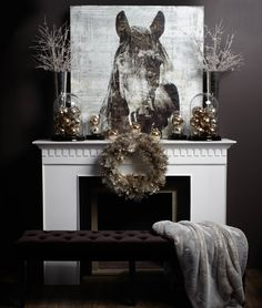 Create a seasonal look with your current artwork by surrounding the mantel with holiday accessories in winter shades of grey and gold. #EquestrianChristmas