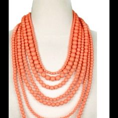 Orange layered bead necklace Excellent condition.  Orange layered bead necklace.  Last picture for outfit inspiration only (selling same necklace in orange).  Bundle and get this dirt cheap.  :) Jewelry Necklaces