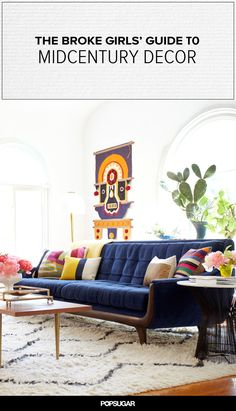 Midcentury living room with navy sofa and sputnik chandelier.