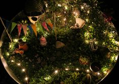 HUGE image of lights used in a fairy garden. Hit garage sales, cheap thrift shops, and your storage area for fairy garden accessories. I love to see a fairy garden with lights on a warm summer night.