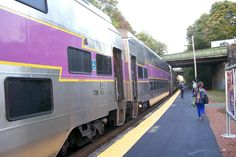 Bilevel coach cars at Wellesley Hills Inbound platform and a train at Wellesley Hills MBTA Commuter Rail station