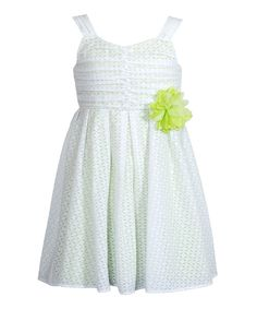Fresh, sweet and blossoming with elegant details, this frock will make a mini miss look prettier than a dainty daisy. A trusty lining makes is doubly durable, and when it needs washing, just toss it into the machine for effortless care.