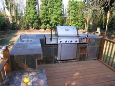 Don't buy an expensive outdoor kitchen and BBQ island set from the store—it is easy, cheap, and fun to build your own. Outdoor Cooking Area, Build Outdoor Kitchen, Outdoor Kitchen Countertops, Outdoor Kitchen Design, Outdoor Kitchens, Simple Outdoor Kitchen, Outdoor Spaces, Outdoor Island, Backyard Kitchen