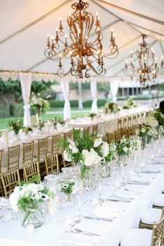 Tent on the grass Love this tent with chandeliers and pretty floral #wedding #reception