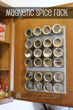 You could also hang a sheet of tin on the inside of your cabinets to create a magnetic spice rack. | 31 Insanely Clever Ways To Organize Your Tiny Kitchen