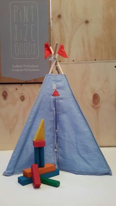 Sky Blue 100% linen with Orange flags.  Available at Pint Size Goods.