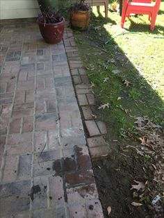 If you're lazy, you use the broken brick pavers and try to extend your patio.  It looks better as dirt.