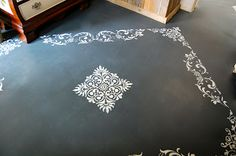 Stencils on a cement floor-painted with Chalk Paint (tm) decorative paint and a variety of Royal Design Studio stencils. SO easy!