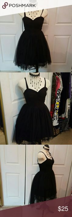 """AMERICAN RAG LITTLE BLACK DRESS M Be the Black Swan in this gorgeous lbd with a cotton bodice, adjustable straps, and 2 layers of skirting. One layer is tulle. I put in a petticoat for the full effect for the photos. It's not included. Bust measures 19""""armpit-armpit and the waist laid flat measures approximately 17"""" stretched. The entire back is elastic and the bust is ruched. In excellent condition. American Rag  Dresses High Low"""