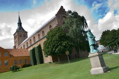 Odense Cathedral and the Hans Christian Andersen sculpture.