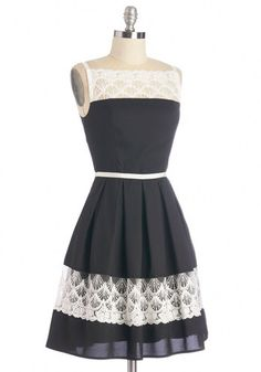 Ever the loyal friend, you've showed up early to help your BFF perfect her party spread, cutting veggies and chilling drinks in this lacy A-line dress! An illusion neckline with matching lace panel at the skirt, and calming hues of grey and white make this sleeveless party dress perfect for swishing around the kitchen.