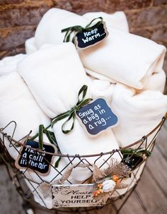 Keep your guests nice and toasty with these fun ways to warm up your cold weather wedding, like these comfy blankets to bundle up in!
