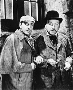 Sherlock Holmes and Dr. John Watson played by Basil Rathbone and Nigel Bruce Sherlock Holmes Elementary, Sherlock Holmes Stories, Adventures Of Sherlock Holmes, Sherlock Actor, Sherlock Bbc, Classic Movie Stars, Classic Movies, Detective, Cartoon Books