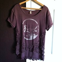 """Rare Vintage Free People maroon hi-lo top Vintage free people hi -lo maroon top  with faded logo , crochet bottom . In perfect condition . Tag says xs fits more like a medium to large more on the large side . The material is on the thicker side .  Front measurements are 18"""" long 17"""" bust . Back measurements is 25"""" long . Free People Tops Blouses"""