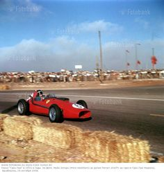The Morocco Grand Prix; Casablanca, October 19, 1958. Wearing a darkvisor against the late afternoon sun, Mike Hawthorn corners his Ferrari 246/F1 on his way to the second place finsih behind Stirling Moss which will give Hawthorn the 1958 World Champions(Photo by Klemantaski Collection/Getty Images)
