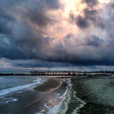 Skies are blinking at me I see a storm bubbling up from the sea ... It's coming #Closer #tramonto #seaside #rimini #igitalia #sunset #seascape #suncape #comeandsea #kingsofleon by zivaja