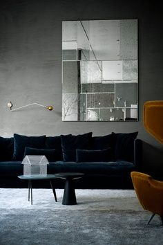 Love the teal sofa, cognac wing chair and gray walls!
