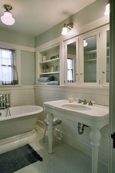 Bathroom with original fixtures and reproduction lighting in house built in 1911 and partially remodeled in 1922