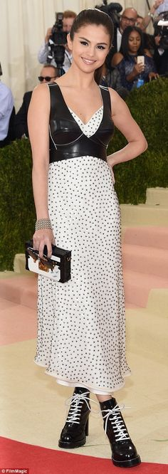 Monochromatic: Taylor's BFF Selena Gomez went for a quirky black and white Louis Vuitton g...