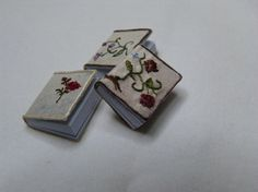Miniature covered book hand embroidered by LatchkeyAndJonquil, €15.00