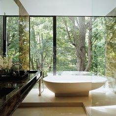 All minimalist houses should be surrounded by woods so you can have bathrooms like this!