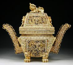 """A Big Chinese Antique Carved Ivory Censer: resting on four beast shaped feet, with two widely flared handles and a lion dog finial on the cover  Dimensions: H: 15-1/2""""; W: 18-1/2"""""""