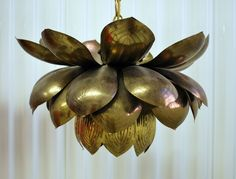 Individual hand-cut capiz shells are edged in silver metal and assembled like a stained-glass window to create this blooming lotus chandelier. Description from ochandelier.net. I searched for this on bing.com/images