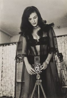 Bunny Yeager in Black Lace with Her Rolleiflex Camera, 1955  Photo by Jeff McLane