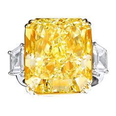 Natural Fancy Yellow Diamond Ring. (Not my style, but amazing to see a trurly natural yellow diamond ofbthis size, it's over a million dollars too.)