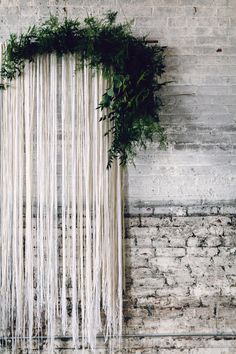 streamer backdrop with greenery - photo by Danfredo Photos + Film http://ruffledblog.com/nordic-industrial-wedding-inspiration
