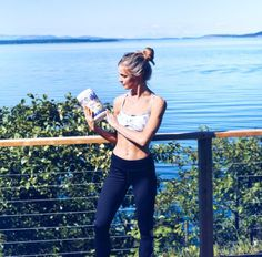 SPH Ambassador Justine D. & her Post Workout Sun Pyramid Health Raw Vegan Protein tub