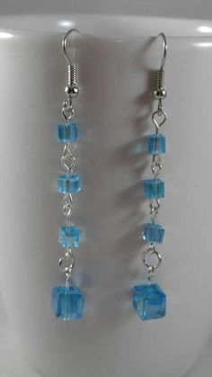 Check out this item in my Etsy shop https://www.etsy.com/listing/545356521/beautiful-blue-drop-and-dangle-earrings