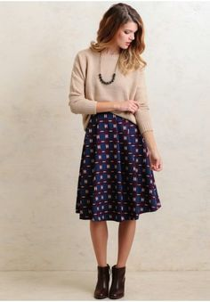 Beige sweater with A-line skirt