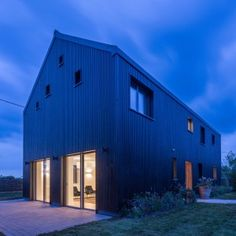 Gresford Architects completes energy-efficient home modelled on a traditional barn