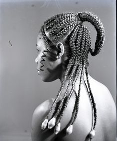 """J.D. Okhai Ojeikere. """"Hairstyles"""" will be his most known collection, involving almost 1000 different hairstyles that give an image of the African woman. He finds these """"sculptures for a day"""" on the street, at a marriage or at work."""