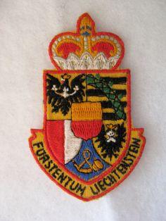 Vintage embroidered souvenir patch from Liechtenstein  Measures 3 by 2 inches  In good condition as shown in photograph  Liechtenstein has the highest
