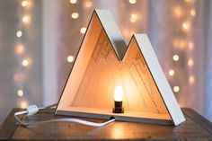 I N T E R N A T I O N A L C U S T O M E R S: The necessary adapters for your region will be included in your order. Contact me directly with any questions.  --------------------  This handmade mountain range night light will add a touch of originality and whimsy to your decor. The light softly glowing from the laser cut pattern on its face, and cast from the open back can either gently light your way in the dark, or add a warm ambiance to any room.  --------------------  S P E C I F I C A T…