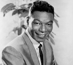 "Nat King Cole. He has a fantastic version of ""Almost like Being in Love.""  Makes you want to dance."
