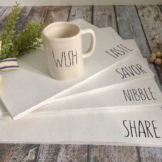 "Rae Dunn inspired placemats. Hand painted, tall and skinny lettering in black on pure white chalk paint. 44 words available including Christmas theme, Halloween, bridal, farmhouse, Thanksgiving, and food related. 1/4"" plywood shellacked for durability"