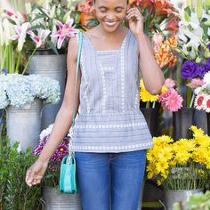 Happy #MayDay! Today's the perfect excuse to treat ourselves to fresh flowers in a pretty peplum. (Dallas Top)