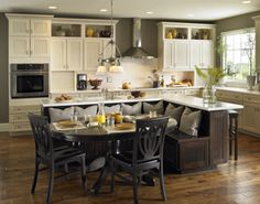 Interesting idea...build onto kitchen cabinets to fill empty space above existing cabinets.