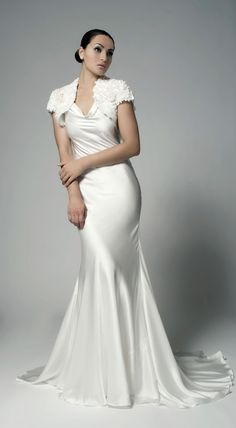 Dazzle on your wedding day in this beautiful organic silk Esperia gown. This clean and pure style is flatters with its luminous glow from the cowl neck to the fishtail skirt. The silk coverage accentuates a very womanly figure with the bias cut and scoop back and leaves the brides sentiments to shine through.