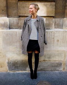 Grey peacoat, French striped sweater, black mini-skirt, thigh-high boots and a happy smile.