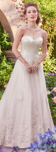 Rebecca Ingram Wedding Dress   This tulle A-line features lovely lace appliqués floating over a ruched bodice, sweetheart neckline, and eye-catching hem   @maggiesottero   #rebeccaingram #rebeccabride