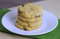 4 Ingredient Cake Mix Cookies - Who knew you could bake cookies from a box of cake mix?! This cake mix cookies recipe only takes 7 minutes to bake, and is stuffed with bits of Reese's peanut butter cups. You can make these with any flavor cake mix and any add-ins you want!