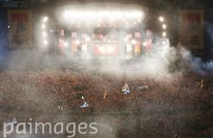 An aerial view of Calvin Harris performing on the Main Stage at the T in the Park festival, held at Balado Park in Kinross, Scotland.