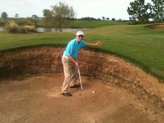 FCWT staff member, Foon, in one of the bunkers at the FCWT Junior Golf Tournament at Eagle Creek.  Register at www.fcwtgolf.com