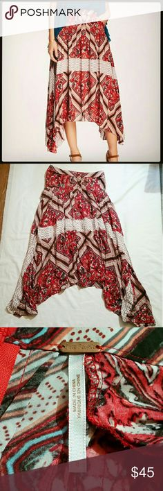 """Free People paradise skirt Gorgeous skirt by Free People in the """"Paradise"""" design. Sits at the waist, handkerchief shaped skirt which hits just past the knee to the mid-calf, with longer sides. Mixed floral stripe print with panels of spotted fabric throughout. Beautiful boho piece by a great brand.  100 percent rayon. Very light, airy fabric, similar to a thin cotton. Great for spring and summer, and for the summer music festivals. Free People Skirts Midi"""